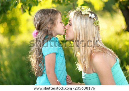 portrait of mother and daughter in nature