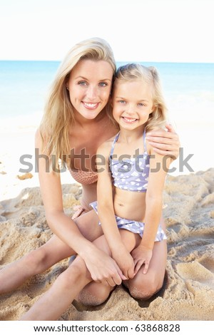 Portrait Of Mother And Daughter On Summer Beach Holiday - stock photo