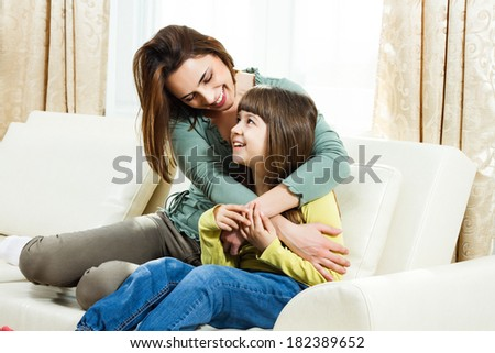 Portrait of mother and daughter spending time together at their home,Family time