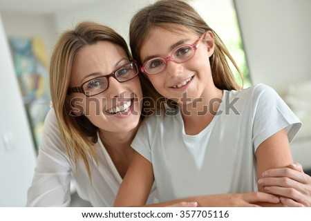 Portrait of mother and daughter with eyeglasses - stock photo