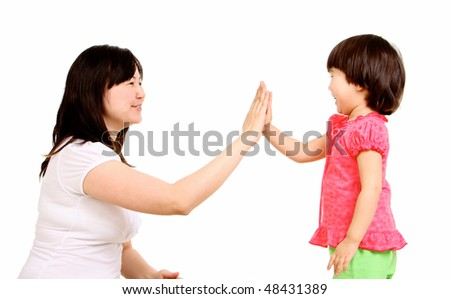Portrait of mother and small daughter touching their palm