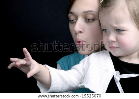 Portrait of mother and unsatisfied baby girl - stock photo