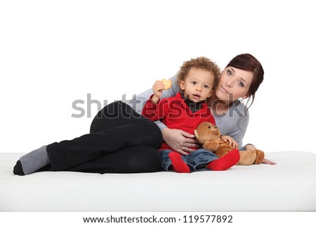 portrait of mother posing with mixed-race son - stock photo