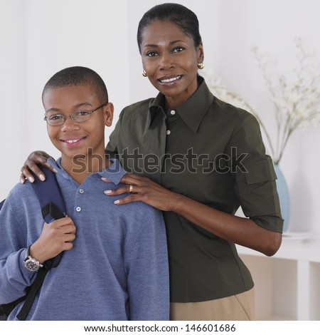 Portrait of mother standing with son