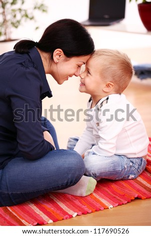 Portrait of Mother with happy son at home - stock photo