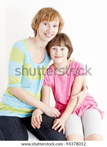 portrait of mother with her daughter - stock photo