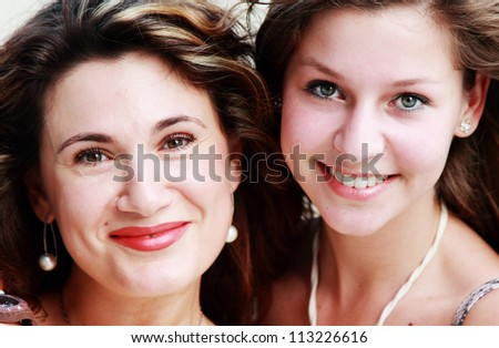 portrait of mother with teenage daughter - stock photo