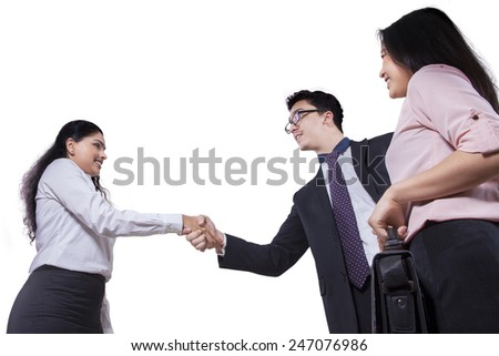 Portrait of multi ethnic business team handshaking, isolated on white background