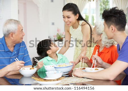 Portrait Of Multi-Generation Chinese Family Eating Meal Together - stock photo