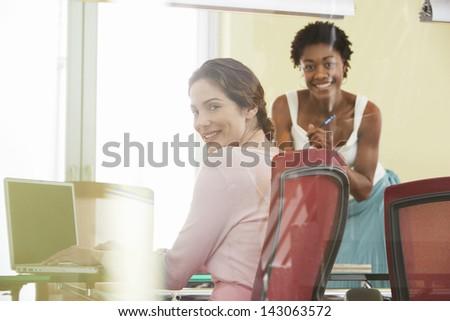 Portrait of multiethnic businesswomen in conference room - stock photo