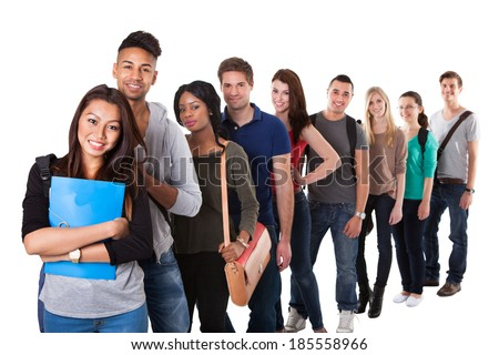 Portrait of multiethnic college students standing in a line over white background - stock photo