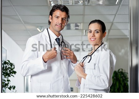 Portrait of multiethnic medical professionals smiling while standing together - stock photo