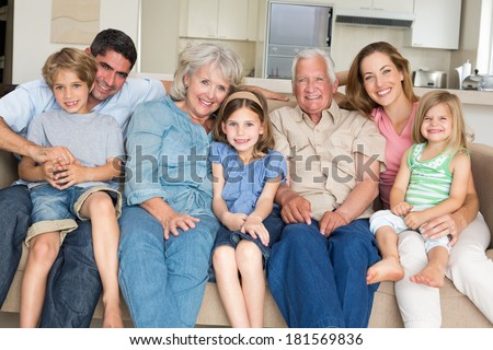 Portrait of multigeneration family spending leisure time at home - stock photo
