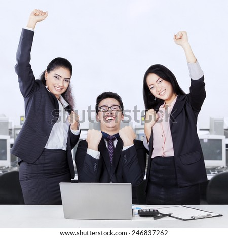 Portrait of multiracial business team celebrating their achievement in the office - stock photo