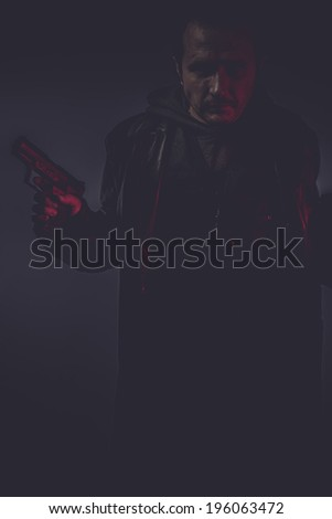 portrait of murderer with gun - stock photo