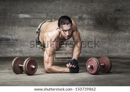 portrait of muscle athlete looking at camera with intense gaze - stock photo