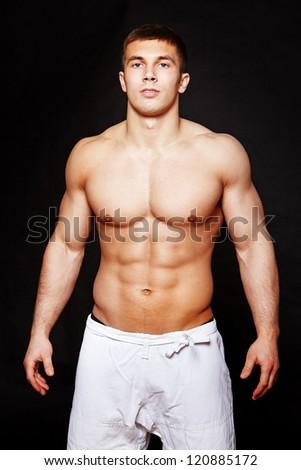 Portrait of muscle man posing in studio - stock photo