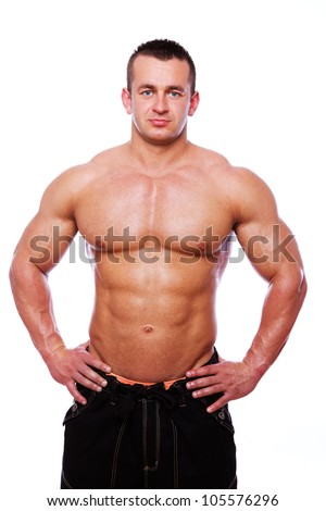 Portrait of muscle man posing on competition - stock photo