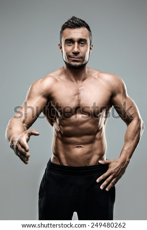 Portrait of muscular man with an open hand for a greeting