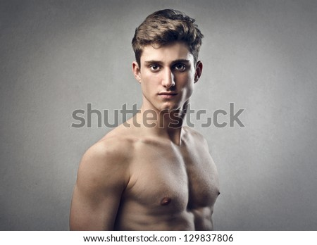 portrait of muscular young man - stock photo