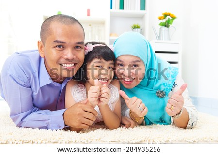 Portrait of muslim family - stock photo