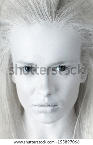 Portrait of mysterious albino woman - stock photo