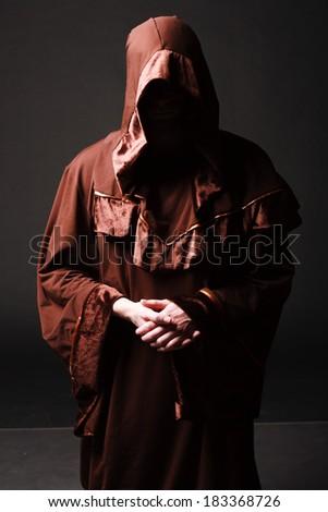Portrait of mystery unrecognizable monk in robe - stock photo