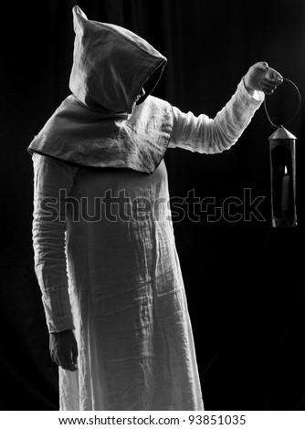 Portrait of mystery woman in robe - stock photo