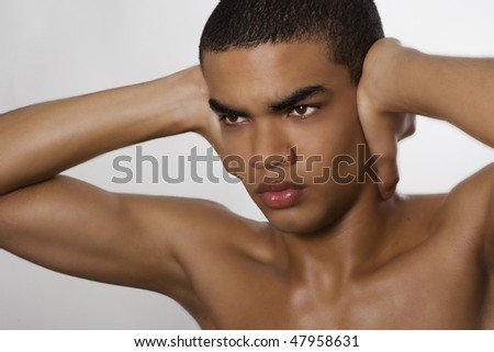Portrait of naked man covering his ears. - stock photo