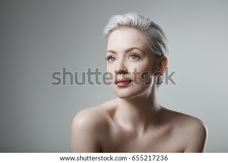 Portrait of natural beauty woman with short platinum blonde hair.