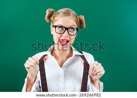 Portrait of nerd student girl in front of blackboard - stock photo