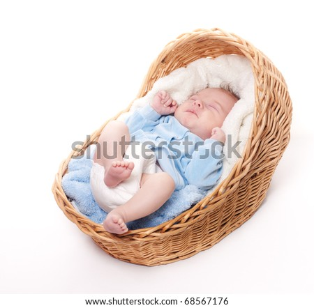 Portrait of newborn baby sleeping in basket with towel isolated over white background. Little baby sleeping alone and waiting for his parents: mother and father. - stock photo