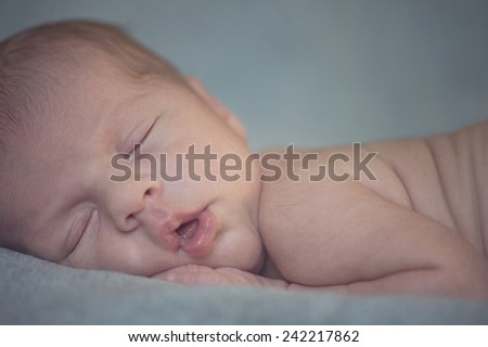 Portrait of Newborn Sleeping Baby Peacefully with Open Mouth - stock photo