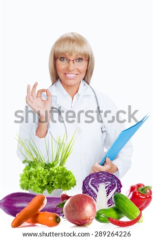 Portrait of nice smiling doctor  on white back - stock photo