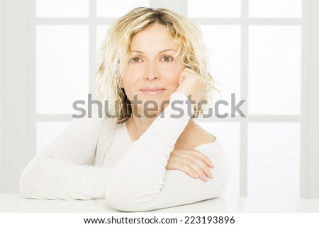 Portrait of nice 40 years old woman - stock photo