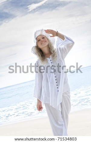 Portrait of nice young woman  having good time on tropical beach