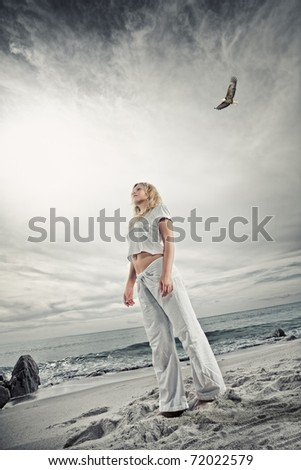 Portrait of nice young woman  having good time on tropical beach - stock photo