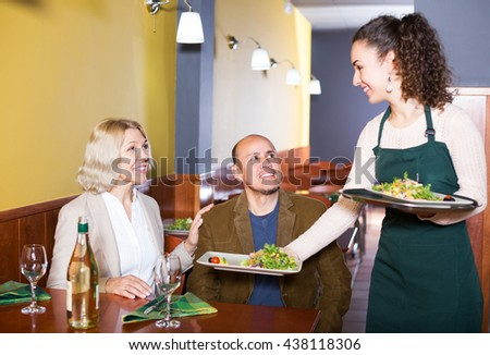 Portrait of nippy and ordinary elderly couple having dinner