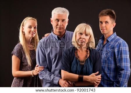 portrait of noble family isolated on dark background - stock photo