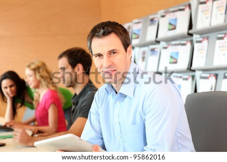 Portrait of office worker with tablet - stock photo