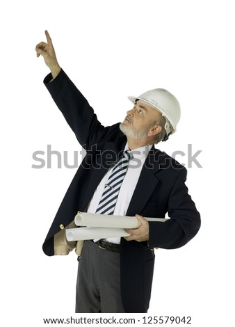 Portrait of old architect pointing up against white background - stock photo