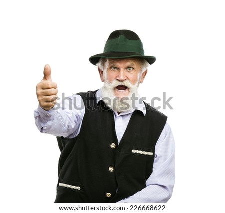 Portrait of old bearded bavarian man in traditional hat with thumbs up isolated on white background - stock photo