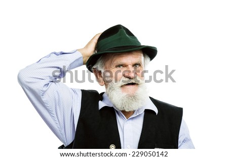 Portrait of old bearded bavarian man raising his hat in a greeting sign in studio on white background - stock photo