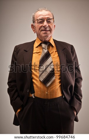 Portrait of old man in suit - stock photo