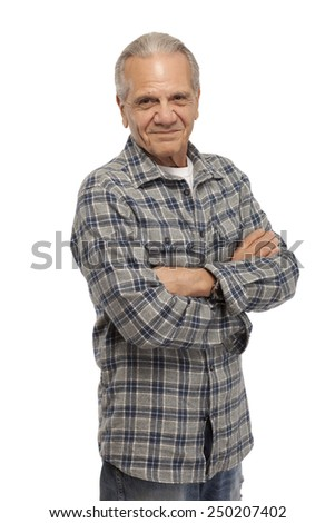 Portrait of old man standing with arms crossed against white background - stock photo