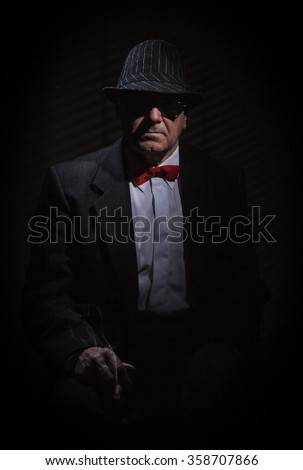 Portrait of Old man with cigar and glasses. - stock photo