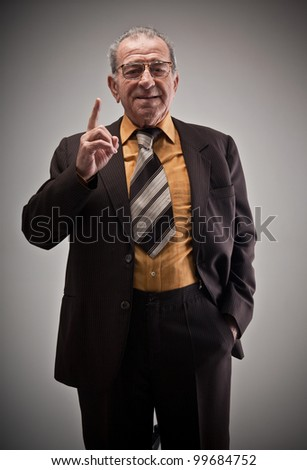 Portrait of old man with finger up - stock photo