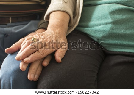 Portrait of old people holding hands