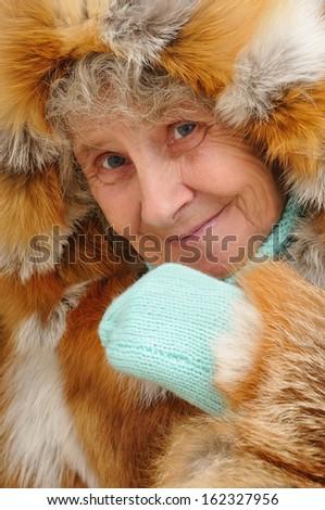 Portrait of old woman fur coat - stock photo