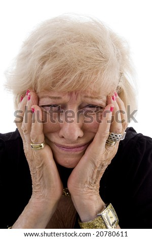 portrait of old woman holding her face on an isolated background - stock photo